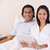 Young couple sitting on the bed with their tablet pc stock photo © wavebreak_media