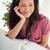 uśmiechnięty · brunetka · student · patrząc · na · zewnątrz · biurko - zdjęcia stock © wavebreak_media