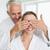 happy man covering his partners eyes in the morning stock photo © wavebreak_media