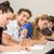 Students writing notes in classroom stock photo © wavebreak_media
