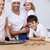 smiling family baking in the kitchen stock photo © wavebreak_media