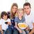 Loving family watching television sitting on sofa at home stock photo © wavebreak_media