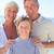 nagyszülők · unoka · tengerpart · égbolt · víz · mosoly - stock fotó © wavebreak_media