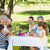 Extended family having lunch in lawn stock photo © wavebreak_media