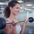 fit smiling woman lifting barbell stock photo © wavebreak_media