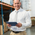 manager using digital tablet in warehouse stock photo © wavebreak_media