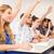 Students raising hands in classroom stock photo © wavebreak_media