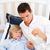 Portrait of an attractive father checking his son's temperature stock photo © wavebreak_media