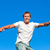 portrait of a caucasian man jumping in the air outdoor against a blue sky background stock photo © wavebreak_media