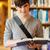 jóvenes · feliz · hombre · pie · Universidad · biblioteca - foto stock © wavebreak_media