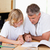 Father helping son with his homework stock photo © wavebreak_media