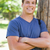 Close-up of a smiling young man leaning against a tree in a park stock photo © wavebreak_media