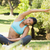 healthy and beautiful woman doing stretching exercise in park stock photo © wavebreak_media