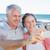 happy casual couple taking a selfie by the coast stock photo © wavebreak_media