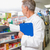 senior pharmacist reading medicine and holding clipboard stock photo © wavebreak_media