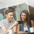 smiling friends with chocolate cake using smartphone stock photo © wavebreak_media
