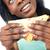 Smiling young woman eating a sandwich  stock photo © wavebreak_media