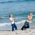 幸せな家族 · 演奏 · 戦争 · ビーチ · 少女 · 男 - ストックフォト © wavebreak_media