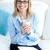 очаровательный · улыбаясь · молодые · деловая · женщина · очки - Сток-фото © wavebreak_media