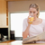 Young woman reading the news while drinking orange juice in her kitchen stock photo © wavebreak_media