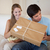 Smiling couple opening a package in their living room stock photo © wavebreak_media