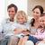 улыбаясь · семьи · Смотря · телевизор · вместе · гостиной · домой - Сток-фото © wavebreak_media