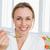 glimlachende · vrouw · badjas · granen · home · keuken · vrouw - stockfoto © wavebreak_media