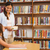 teacher and girl reading book in library stock photo © wavebreak_media