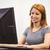 student sitting at the computer room wearing headset stock photo © wavebreak_media