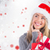 composite image of festive blonde holding christmas gift and bag stock photo © wavebreak_media