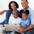 Smiling family using a laptop stock photo © wavebreak_media
