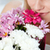 close up of a woman smelling a bunch of flowers stock photo © wavebreak_media