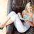 encantador · mujer · lectura · libro · sesión · sofá - foto stock © wavebreak_media