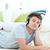очаровательный · молодым · человеком · слушать · музыку · полу · гостиной - Сток-фото © wavebreak_media