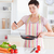 cute woman cooking in the kitchen stock photo © wavebreak_media