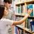 dwa · młodych · studentów · biblioteki · wybierać · książki - zdjęcia stock © wavebreak_media