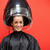 Woman under a hairdressing machine against a red background stock photo © wavebreak_media