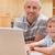 отец · используя · ноутбук · кухне · интернет · ноутбука - Сток-фото © wavebreak_media
