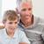 портрет · улыбаясь · отцом · сына · гостиной · семьи - Сток-фото © wavebreak_media