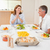 mutlu · aile · birlikte · yemek · masası · gülümseme · erkek · gülen - stok fotoğraf © wavebreak_media