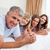happy family lying on the bed together stock photo © wavebreak_media