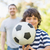 father and son playing football in park stock photo © wavebreak_media