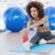 Sporty woman stretching hands to leg in fitness studio stock photo © wavebreak_media