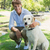 knappe · man · labrador · park · glimlachend · camera - stockfoto © wavebreak_media