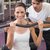 fit brunette using weights machine for arms with trainer helping stock photo © wavebreak_media