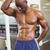 Serious shirtless muscular man posing in gym stock photo © wavebreak_media