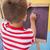 cute little boy drawing on chalkboard stock photo © wavebreak_media
