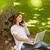 pretty redhead on the phone holding her laptop stock photo © wavebreak_media