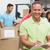 smiling volunteer man taking notes holding clipboard stock photo © wavebreak_media