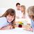 merry family having breakfast sitting on bed stock photo © wavebreak_media